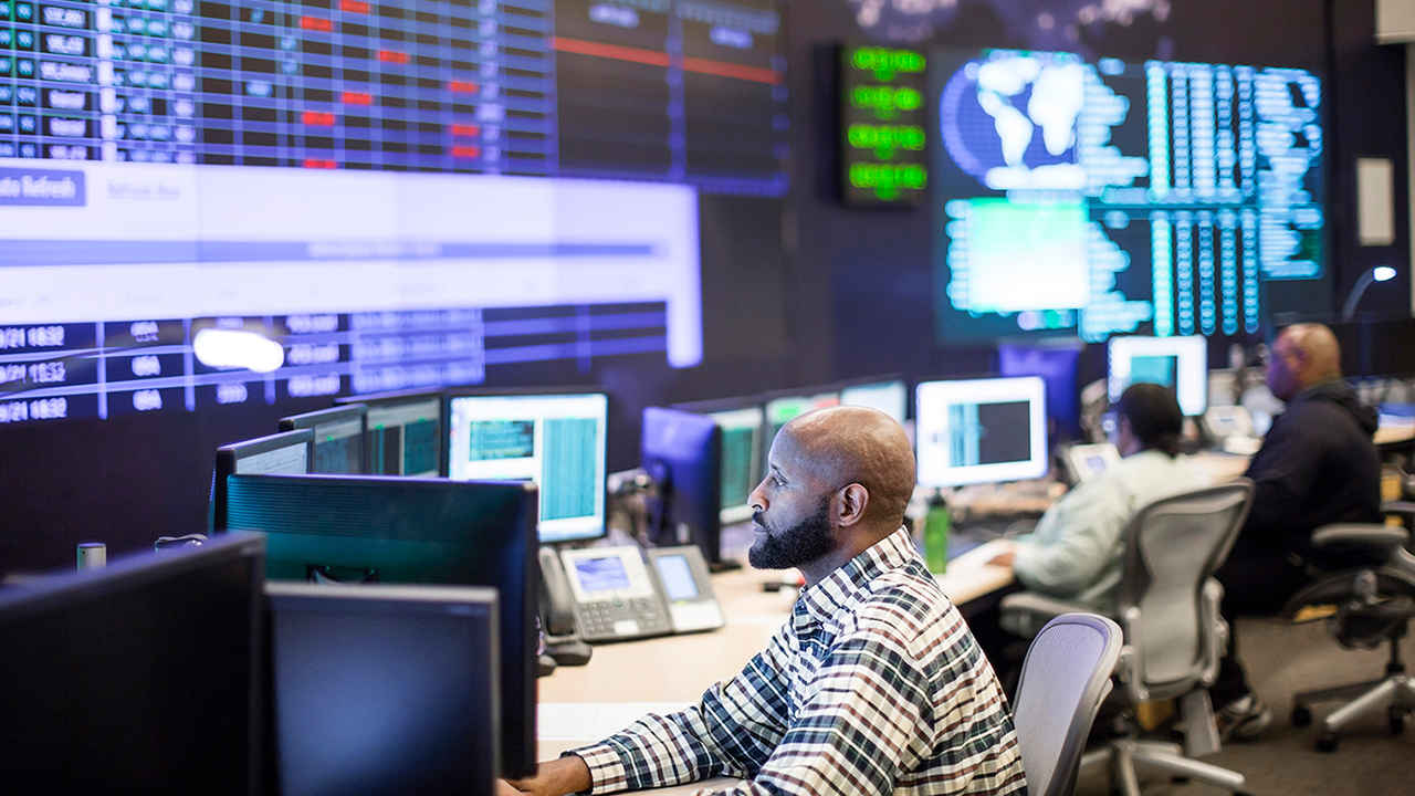 Network operations center (NOC) technicians monitoring critical network elements and engaging in proactive network systems monitoring.